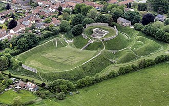 Castle Acre Castle and town walls - Aerial view of the castle, showing the outer bailey (left), inner bailey and barbican (right)