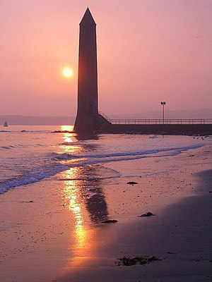 Chaine Memorial - The tower at sunrise from Sandy Bay.
