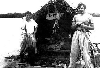 "Che Guevara - Guevara (right) with Alberto Granado (left) in June 1952 on the Amazon River aboard their ""Mambo-Tango"" wooden raft, which was a gift from the lepers whom they had treated"
