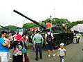 Children Playing on CM-11 Tank Display at Chengkungling 20111009.jpg