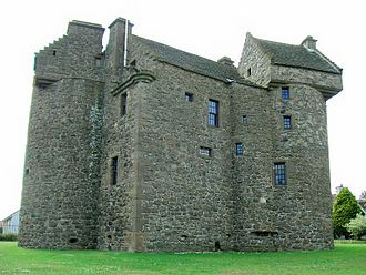 Scottish baronial architecture - Claypotts Castle consists of a rectangular central block with two round towers crowned by square garret chambers. The corners of these chambers or cap-houses are strongly corbelled out over the round form and have crow-stepped gables.