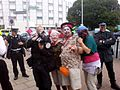 Climate camp at Heathrow - Clowns with police photographer.JPG