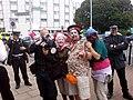 Climate camp at Heathrow - Clowns with police photographer.JPG