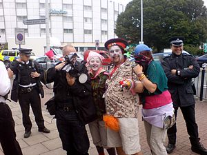 Forward intelligence team - Image: Climate camp at Heathrow Clowns with police photographer