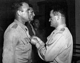 "Clinton D. ""Casey"" Vincent - Vincent receives from Major General Claire Chennault the oak leaf cluster to his Air Medal in December 1944"