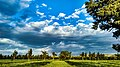 Clouds and green filed.jpg