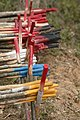 Colour coded marker sticks for UXO clearance areas stored at Taoun Village, Laman District, near Sekong, Lao PDR 2009. Photo- Jim Holmes (10687560663).jpg