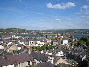 Conwy - A view of the original walled town, viewed from one of the towers. Conwy Castle is visible to the right, with the suspension bridge barely visible.