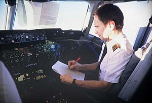 Checklist - A pilot of a DC-10 consulting his checklist.