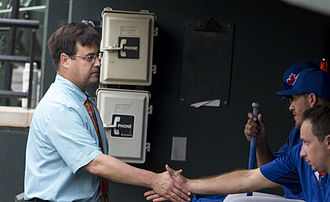 Dan Duquette - Duquette shaking hands with Toronto Blue Jays players in their dugout prior to a game on July 13, 2013