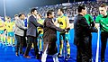 Dharmendra Pradhan and the Minister of State for Youth Affairs and Sports (IC) and Information & Broadcasting, Col. Rajyavardhan Singh Rathore meeting the players at the World Hockey League final, at Kalinga Stadium.jpg
