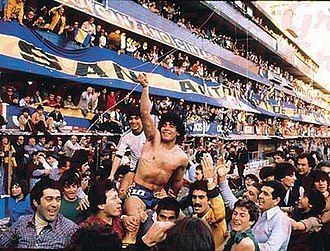 Diego Maradona - Maradona being held aloft by fans of Boca Juniors after winning the 1981 Argentine Primera División