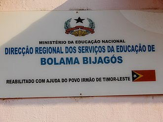 Guinean Portuguese - A sign at the local Department of Education and Training of Bolama, which was rehabilitated with the cooperation from the Government of East Timor