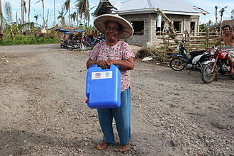 WASH - Distributing jerrycans to help people store clean drinking water in the Philippines