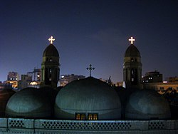 Domes of Saint Mark's Church, standing over the horizon at night, Heliopolis Cairo, Egypt.jpg