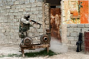 Al-Karmah - A Mossberg 590 being used by a US Marine for door breaching in Karmah in 2005.