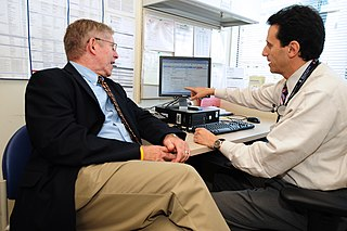 doctor and patient with electronic medical records