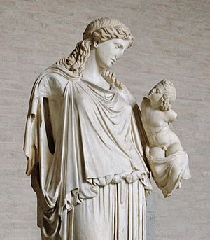 Eirene (goddess) - Statue of Eirene with the infant Ploutos: Roman marble copy of bronze votive statue by Cephisodotus the Elder, now in the Glyptothek, Munich.