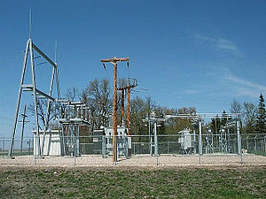 Electrical substation - A 115 kV to 41.6/12.47 kV 5 MVA 60 Hz substation with circuit switcher, regulators, reclosers and control building at Warren, Minnesota. This substation shows elements of low-profile construction; apparatus is mounted on individual columns.