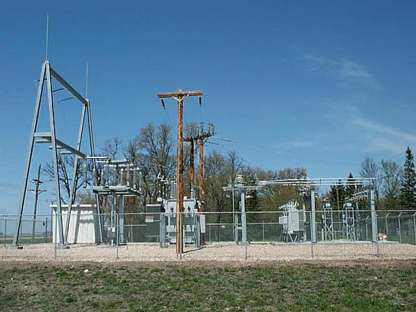 A 115 kV to 41.6/12.47 kV 5 MVA 60 Hz substation with circuit switcher, regulators, reclosers and control building at Warren, Minnesota. This substation shows elements of low-profile construction; apparatus is mounted on individual columns. Electrical Substation.JPG
