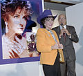Elizabeth Taylor with purple cowboy hat at Neiman Marcus store.jpg