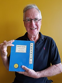 Endymion Wilkinson with Front Cover of his Fifth Edition 10-17-2017.jpg
