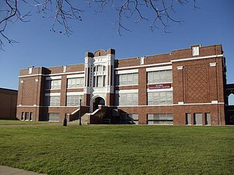 Ennis, Texas - Ennis High School, built in 1916, operated from this location until 1982. Today, it serves as the school district's alternative education center.