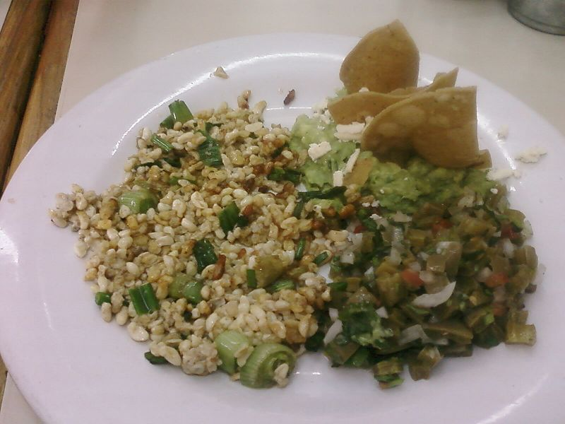 Escamoles on butter, Mexican dish, It has escamoles(left), nopales( right) , avocado (back), onion, tortilla