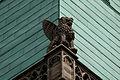 Evangelistensymbolskulptur Markus am Turm von St. Gangolf.jpg