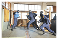 Exercise of SIT detectives equipped with Sasumata.png