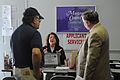 FEMA - 34405 - Public Information Officer and Individual Assistance Worker Explains FEMA Services.jpg
