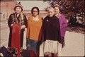 FOUR WOMEN OF THE IOWA INDIAN TRIBE ARE SHOWN WEARING A MODERN VERSION OF THEIR COSTUMES ON THE MAIN STREET OF WHITE... - NARA - 557158.tif