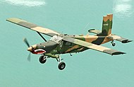 Fairchild AU-23A Peacemaker in flight.jpg