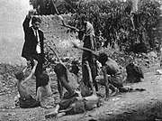 Fake image claiming to be Ottoman official teasing Armenian starved children by showing bread, 1915