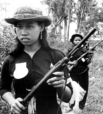 South Vietnamese Self-Defense Force of Kien Dien on patrol Female South Vietnamese Popular Force members on patrol in Ben Cat District.JPEG