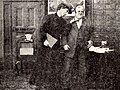 """Film still of 1909 Biograph comedy """"Jones and the Lady Book Agent"""".jpg"""