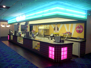 Concession stand - Concession stand of a 1950s-style fine arts movie theatre. Patrons of movie theaters purchase candy and drinks here.