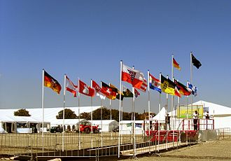 Jalsa Salana - The Liwa-e-Ahmadiyya, the flag of Germany, in front the flags of German states at the Jalsa Salana Germany 2009