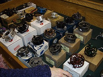 Fly fishing tackle - A variety of fly reels on display at a fly fishing show