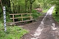 Footbridge and flood depth sign, near Ashreigny - geograph.org.uk - 171295.jpg