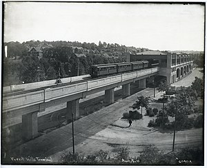 Forest Hills (MBTA station) - A northbound Main Line train with a smoking (S) car on front leaves Forest Hills elevated station in 1910