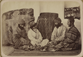Four Jewish Men Seated on the Ground next to Two Large Covered Bundles, Inspecting the Dowry WDL11178.png