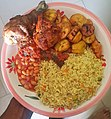 Fried rice, baked beans with fried plantains and chicken.jpg