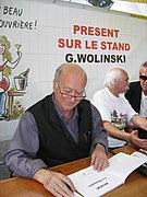 G. Wolinski dédicaçant à la fête de l'Huma 2007-04.JPG