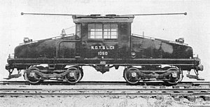 Electric locomotive - A GE steeplecab electric locomotive with trolley poles, for an interurban railroad.