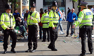 Law enforcement in the United Kingdom - Police Constables and an Inspector of Greater Manchester Police on the beat in Manchester city centre after the 2008 UEFA Cup Final Riots