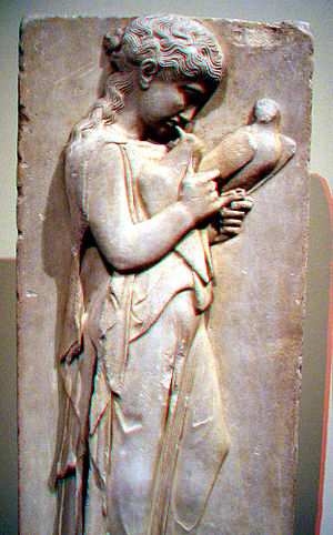 Relief of an affectionate girl playing with two birds.  This ancient Greek stele was sculpted c. 450 BC in the era of Periclean Athens and is now found in the New York Metropolitan Museum of Art.  This grave marker was discovered in 1775 on the isle of Paros, which was home to many gifted sculptors; Parian marble was highly prized in antiquity.