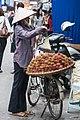Hanoi Vietnam Hawker-selling-Nephelium-lappaceum-01.jpg