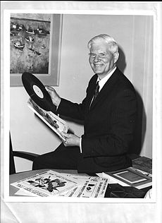Hartman selecting records to broadcast.jpg