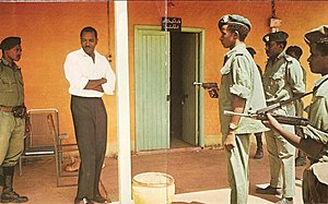 1971 Sudanese coup d'état - Babiker Al Nour under arrest on 22 July, following the counter-coup by Nimeiry loyalists.